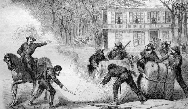 A konföderáció katonái gyapotot égetnek